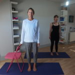 rebeccaallenyoga standing with chair